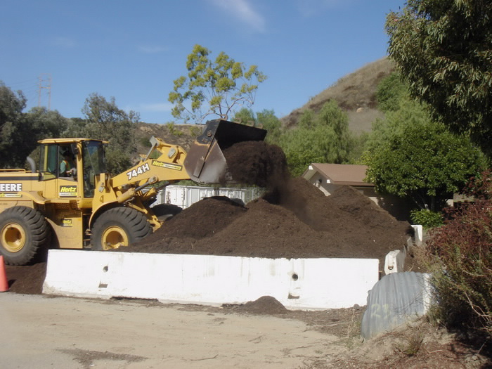 The delivered mulch is then evened out for easy pick up by residents of Los Angeles.