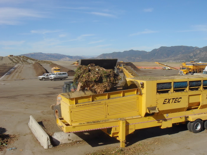 These skip loaders help to lift large amounts of yard trimmings and deposit then into the trammel.