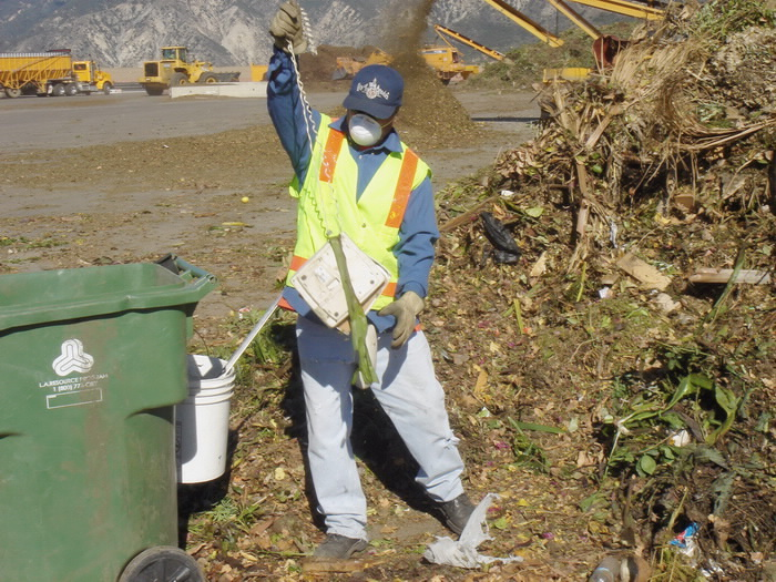 Workers need to remove the contaminants from the greenwaste